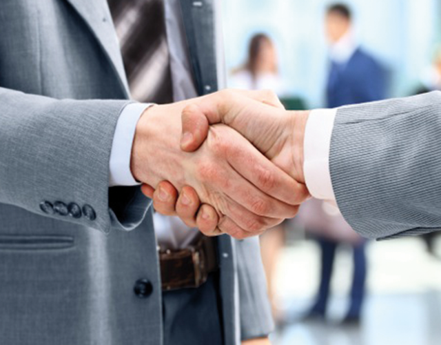 AERZEN service employee and a employee from a company shaking hands