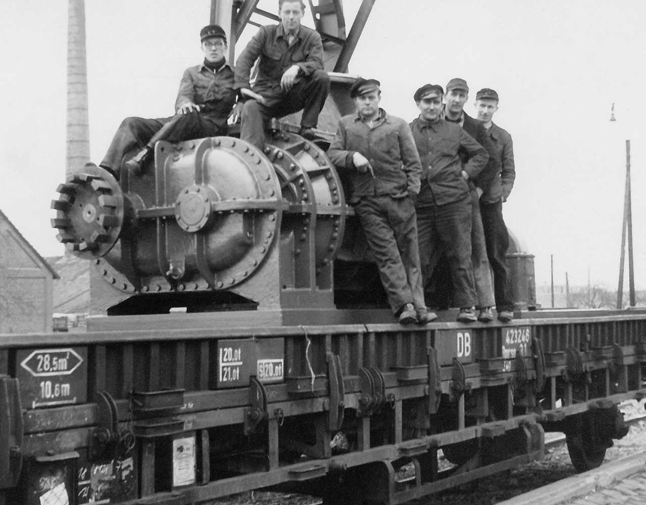 Picture of employees who were sitting on a positive displacement blower which was sent to Berlin by railway